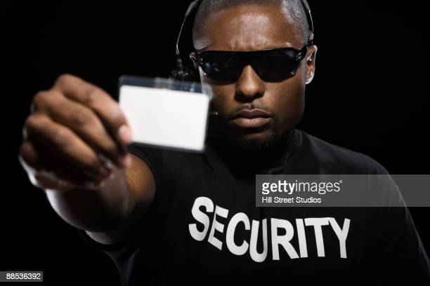 African security guard checking id