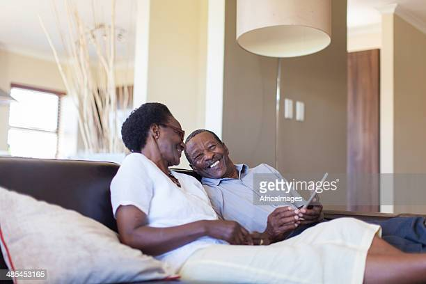 African senior couple working on a digital tablet together