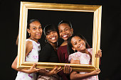 African sisters posing in picture frame