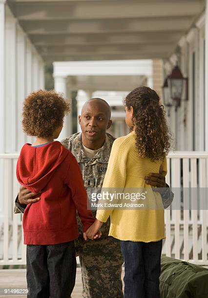 African soldier talking to son and daughter