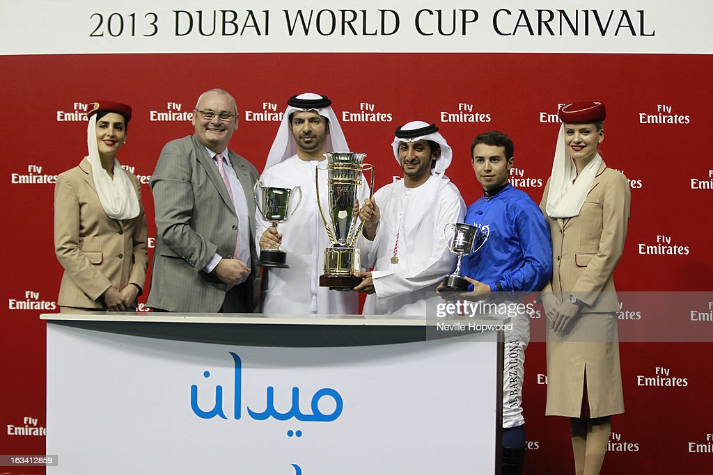 African Story presentation for winning the Group 3 Burj Nahaar race, (L-R) Ian McDougal, Regional Manager of Commercial Operations of Emirates Holidays, Godolphin Trainer Saeed Bin Suroor, Sheikh Juma Al Makoum and Jockey Mickael Barzalona during Super Saturday at Meydan Racecourse on March 9, 2013 in Dubai, United Arab Emirates.