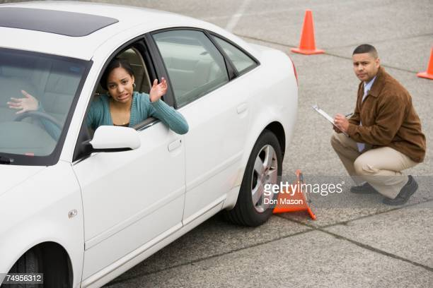 African teenager running over traffic cone at drivers test
