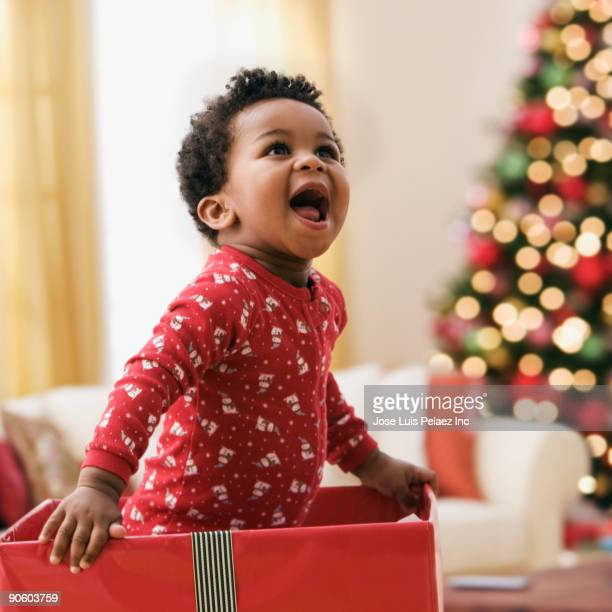 African toddler in Christmas gift box