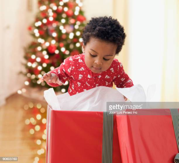 African toddler opening Christmas gift