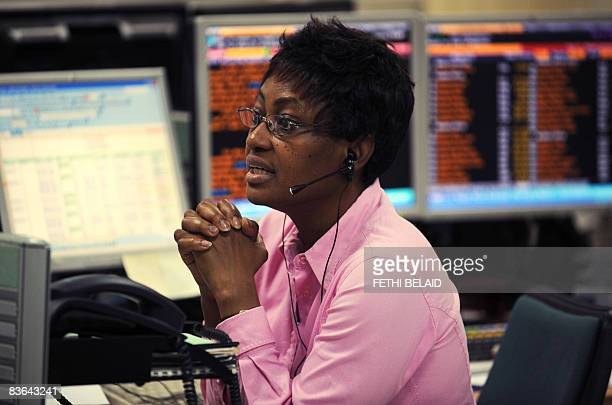 African traders follow the market's movement at the Stock Exchange in African Development Bank on November 11 2008 in Tunis In parallel to the...