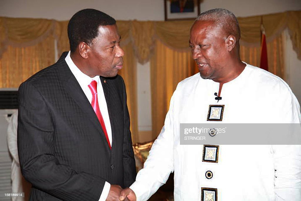 African Union chairman and Benin's President Boni Yayi (L) shakes hand with Ghana's re-elected President John Dramani Mahama in Accra on December 10, 2012, during a visit to congratulate Mahama on his re-election after the just concluded presidential and election.