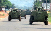 African Union intervention force sit on armoured vehicles during an operation to free the way leading to the north of Bangui on March 25 2014 At...