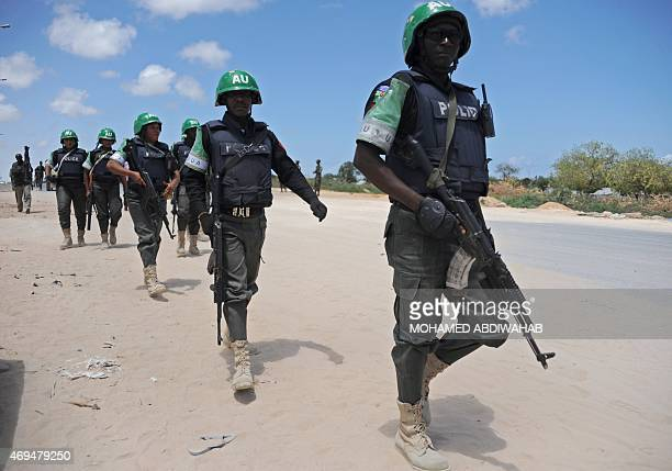 African Union Mission in Somalia officers patrol around the Gashandhiga academy compound during celebrations of the 55th anniversary day of the...