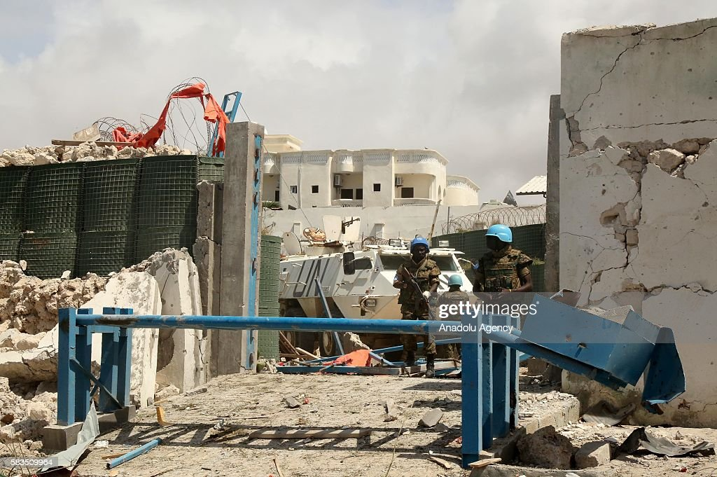 African Union Mission in Somalia soldiers take security measurements after a bomb attack with bombladen vehicles over the United Nations African...