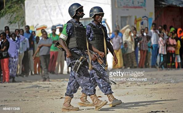 African Union Mission to Somalia soldiers patrol following a car bomb in the Wardhigley District south of Mogadishu on February 27 2015 The bomb...