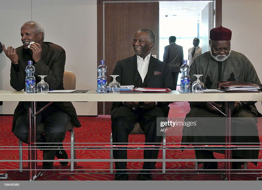 African Union's chief mediator in the talks between Sudan and South Sudan Thabo Mbeki (C), with military advisor Yenus Samora (L) and fellow AU mediator Abdulsalami Abubakar (R) attend the latest round of African Union-led negotiations between the two former civil war foes on January 14, 2013 in Addis Ababa. Security talks between Sudan and South Sudan resumed in Ethiopia Monday, nine days after the leaders of the two countries agreed to implement a raft of deals that have stalled since September. AFP PHOTO / JENNY VAUGHAN