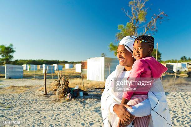 African woman and her daughter at sunrise