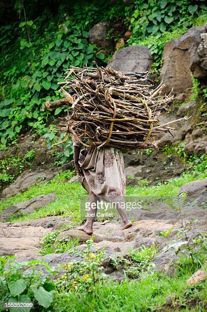 African woman carrying firewood