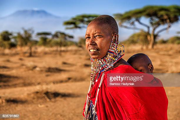 African woman carrying her baby, Kenya, East Africa