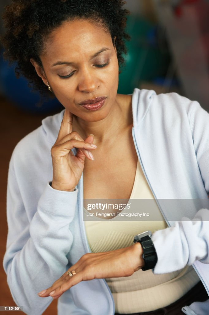 African woman checking pulse