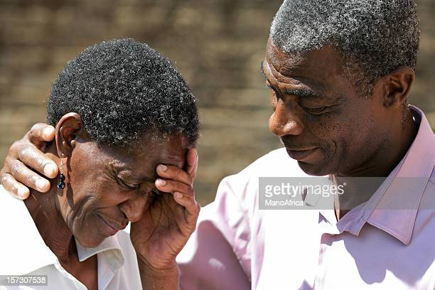 African woman comforted by her husband
