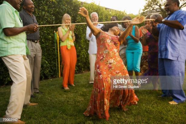 African woman doing the limbo outdoors