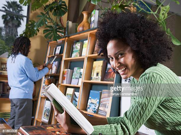 African woman holding book