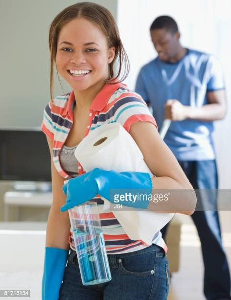 African woman holding paper towels