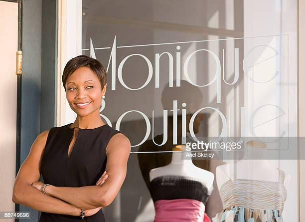 African woman in front of boutique window