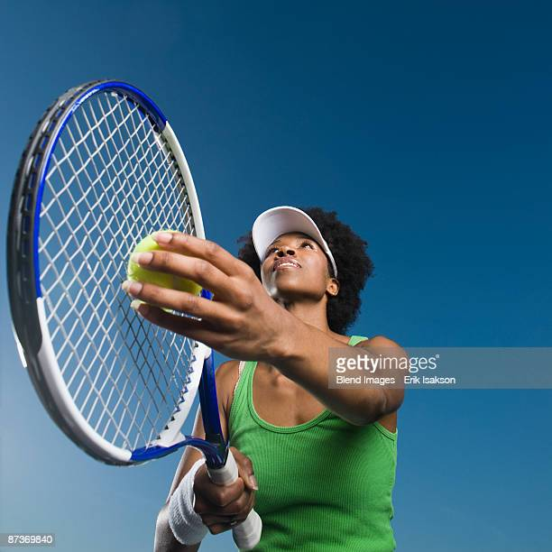 African woman playing tennis
