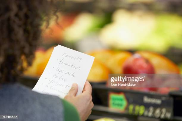 African woman reading grocery list