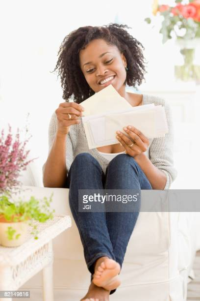 African woman reading mail
