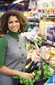 African woman shopping at grocery store