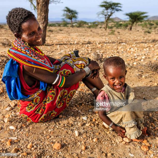 African woman sitting with her baby, Kenya, East Africa