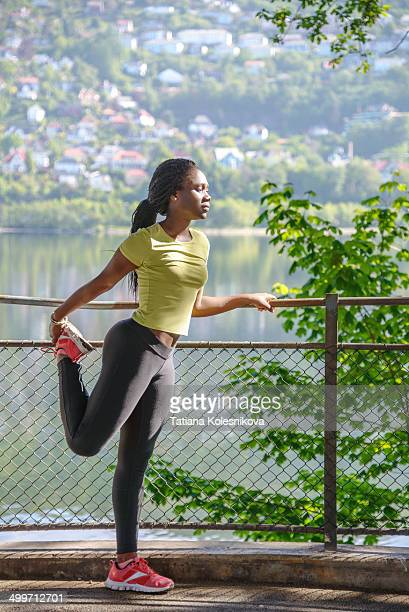 African woman stretching before a work-out
