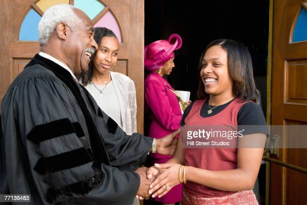 African woman talking to Reverend