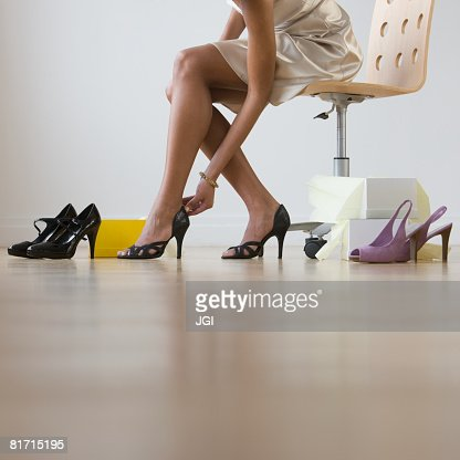 African woman trying on shoes
