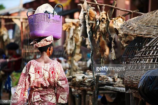 African Woman Walking Through Market