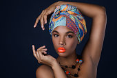 Portrait of African woman with a colorful shawl on her head