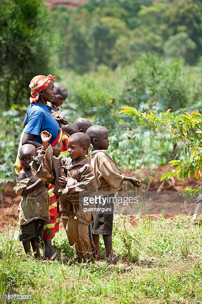 African woman with her children in a field, Burundi, Africa