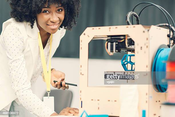 African Woman Working by 3D Printer.