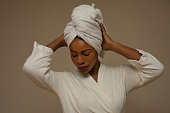 African woman wrapped in towels after bath.
