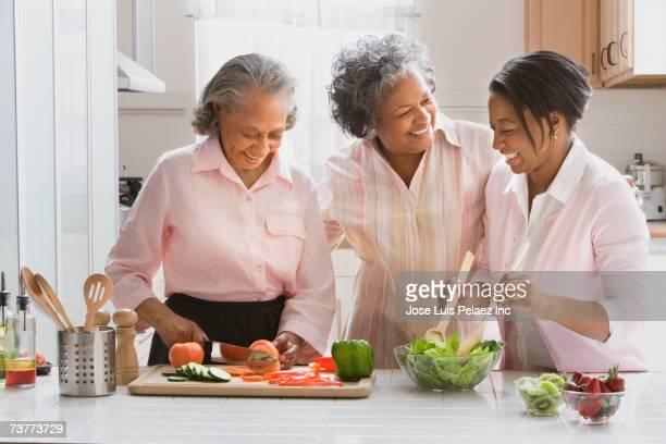 African women preparing food in kitchen