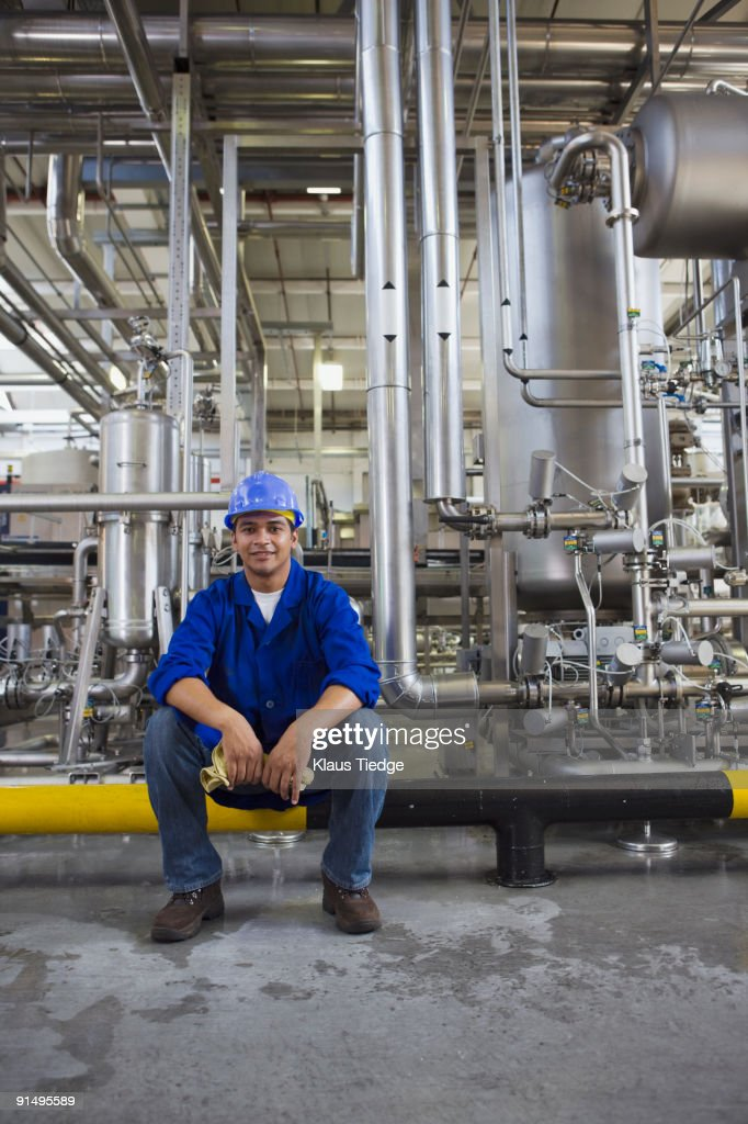 African worker sitting in factory