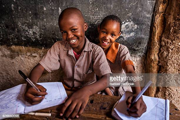 African young boys are learning English language, orphanage in Kenya