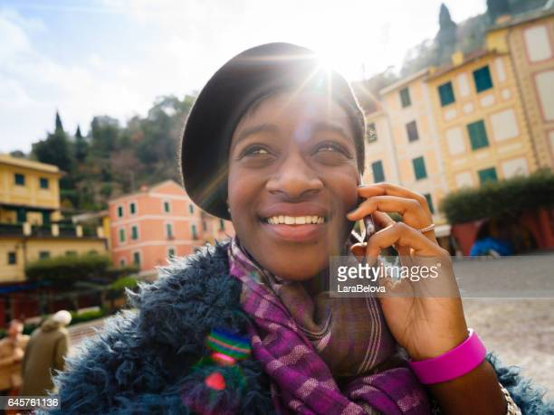 African young tourist woman in Portofino, Italy