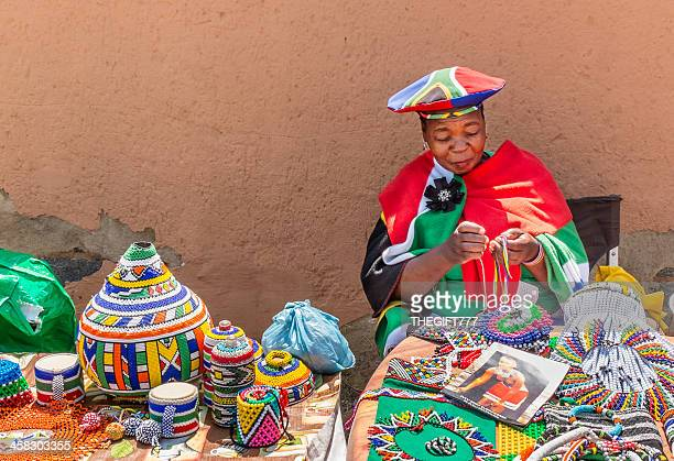African Zulu lady doing beadwork