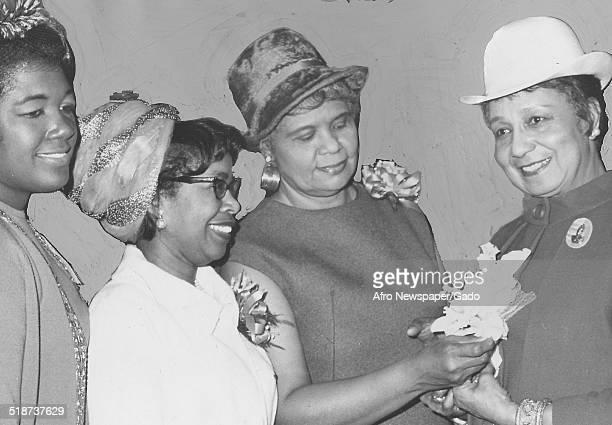 AfricanAmerican actress and singer Etta Moten Barnett and members of the Alpha Kappa Alpha sorority at Ben Franklin Hotel Philadelphia Pennsylvania...