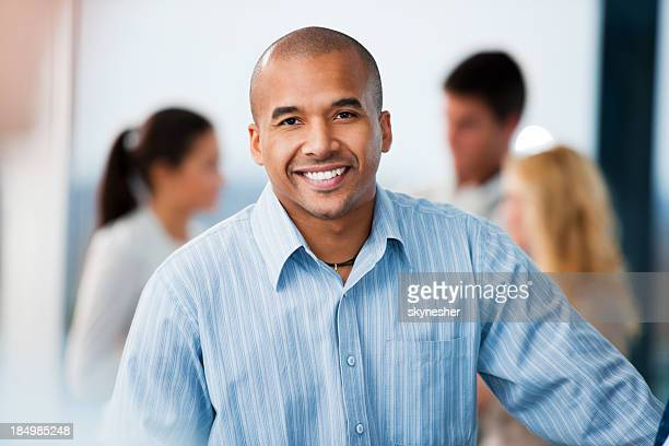 African-American businessman looking at camera.