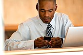 African-american businessman working on PDA.