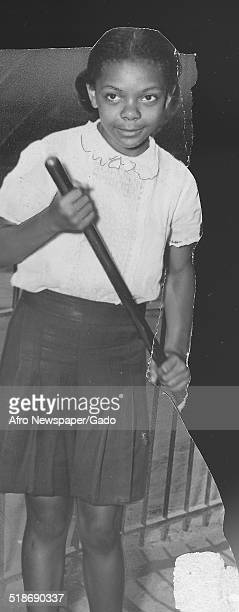 AfricanAmerican child during the Afro American Newspapers Clean Block urban beautification campaign Baltimore Maryland July 17 1943