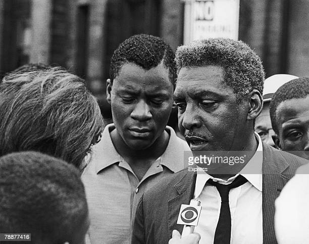 AfricanAmerican civil rights activist Bayard Rustin talks to a reporter during the Harlem Riots in Manhattan 23rd July 1964