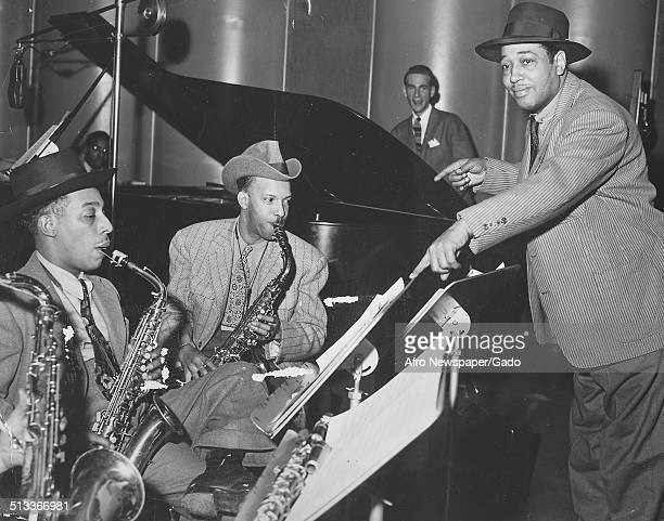 AfricanAmerican composer pianist bandleader and Jazz musician Duke Ellington and a Jazz orchestra playing instruments and singing September 19 1942