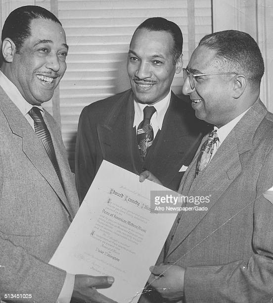 AfricanAmerican composer pianist bandleader and Jazz musician Duke Ellington receiving an award at the Pyramid Club in Philadelphia Philadelphia...