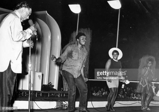 AfricanAmerican composer pianist bandleader and Jazz musician Duke Ellington Tony Watkins and Darlene Huff singing on stage Washington DC July 21 1969
